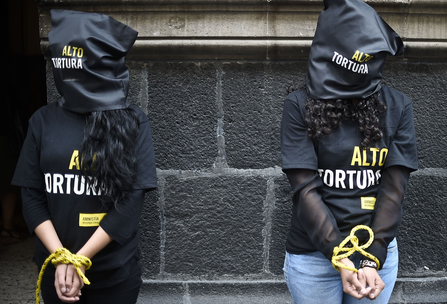 Activists of Amnesty International demonstrate against torture in Mexico, before submitting to the press a report entitled
