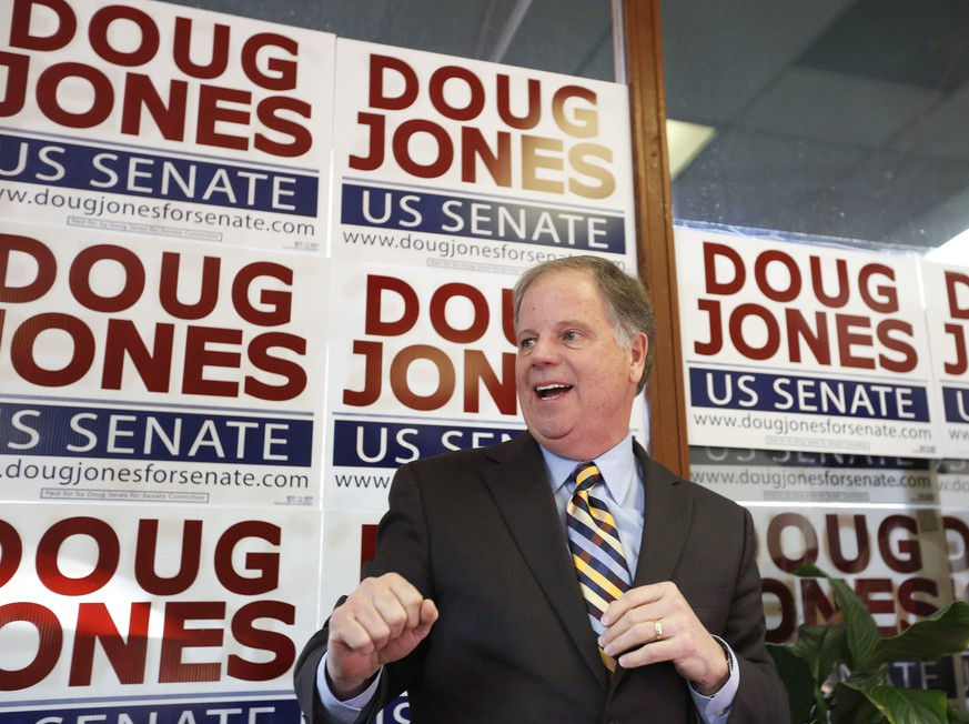 In this Dec. 10, 2017, photo, Doug Jones speaks during a campaign rally in Birmingham, Ala. Jones, a Democrat who once prosecuted two Ku Klux Klansmen in a deadly church bombing and has now broken the Republican lock grip on Alabama, is the state's new U.S. senator.(AP Photo/Brynn Anderson)