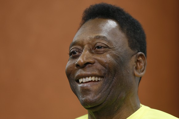 """FILE - In this March 20, 2015, file photo, Brazilian soccer legend Pele smiles during a media opportunity at a restaurant in London. The 74-year-old football great was in a """"stable"""" condition after surgery this week, the Albert Einstein Hospital said in a statement on Thursday, May 7, 2015. (AP Photo/Kirsty Wigglesworth,File)"""