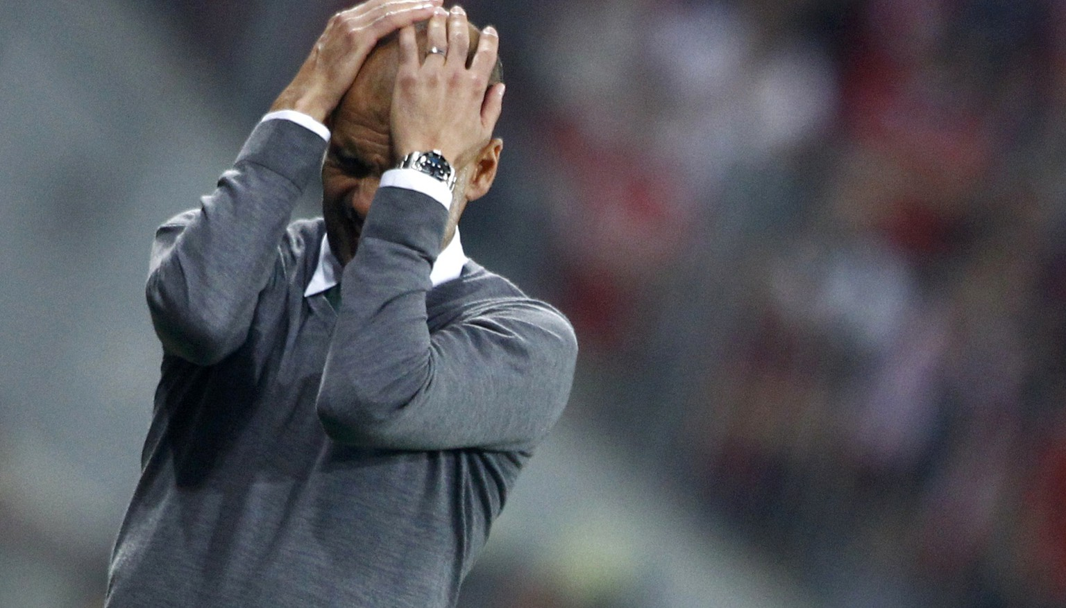 Bayern Munich's coach Josep Guardiola reacts during the Champions League group E soccer match against Manchester City, in Munich September 17, 2014.                                REUTERS/Michaela Rehle (GERMANY  - Tags: SPORT SOCCER)