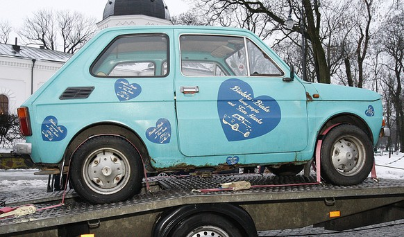 In this photo taken Jan. 21, 2017 in Suwalki, Poland a  Fiat 126p that fans have bought for actor Tom Hanks as a souvenir, sits on a trailer. Fans bought the car after they saw photos he posted of himself jokingly posing with such tiny cars parked in the streets of Budapest, Hungary. The cars were made in Bielsko-Biala, Poland from 1973-2000. A fan in Bielsko-Biala, Monika Jaskolska, organized a public collection for the car which, after an overhaul and a paint job is to be flown to Los Angeles. (AP Photo/ Michal Kosc)