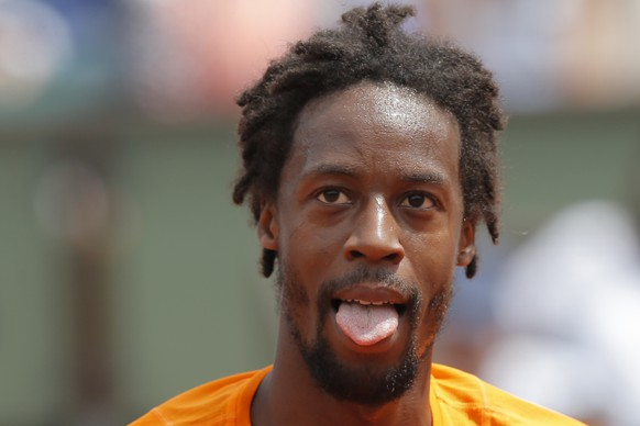 France's Gael Monfils sticks out his tongue as he plays against France's Richard Gasquet during their third round match of the French Open tennis tournament at the Roland Garros stadium, in Paris, France. Sunday, June 4, 2017. (AP Photo/Michel Euler)