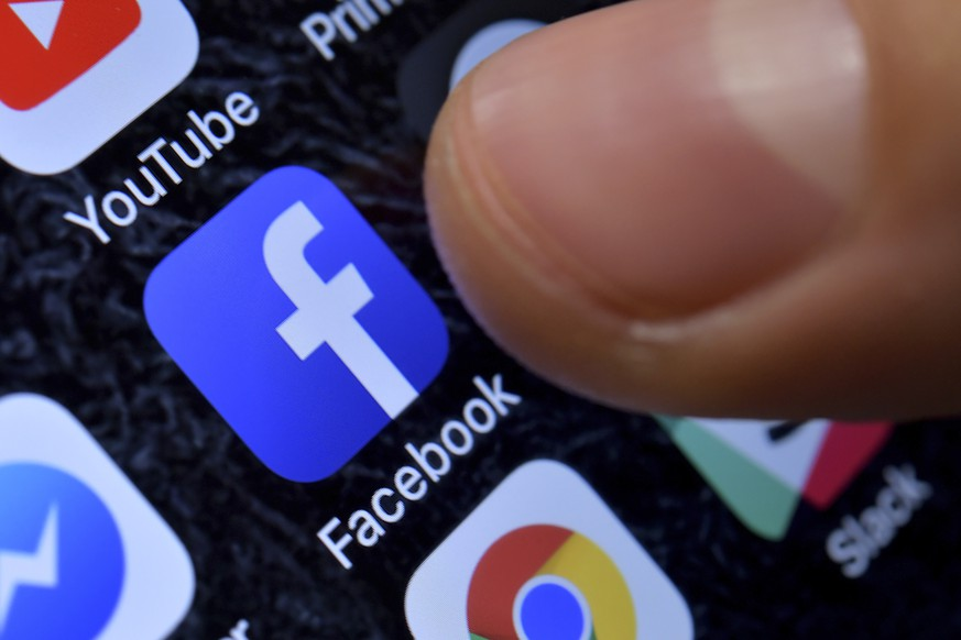 epa07524769 (FILE) - A close-up image showing the Facebook app on an iPhone in Kaarst, Germany, 08 November 2017 (reissued 24 April 2019). Facebook is to release their 1st quarter 2019 results on 24 April 2019.  EPA/SASCHA STEINBACH