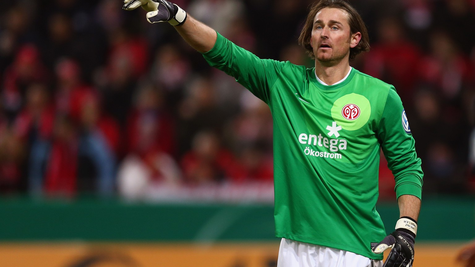 MAINZ, GERMANY - FEBRUARY 26: Goalkeeper Heinz Mueller of Mainz gestures during the DFB Cup Quarter Final match between FSV Mainz 05 and SC Freiburg at Coface Arena on February 26, 2013 in Mainz, Germany.  (Photo by Alex Grimm/Bongarts/Getty Images)