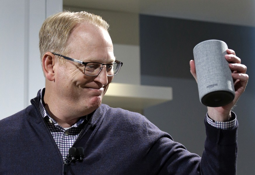 David Limp, senior vice president of Devices and Services at Amazon, smiles as he displays a new Amazon Echo during an event announcing several new Amazon products by the company, Wednesday, Sept. 27, 2017, in Seattle. Amazon says it is cutting the price of its Echo smart speaker to $100 from $180, improving the sound quality and upgrading its appearance with six new