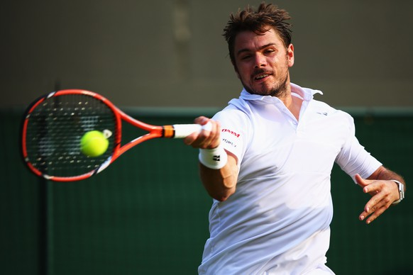 LONDON, ENGLAND - JULY 01:  Stanislas Wawrinka of Switzerland plays a forehand in his Gentlemens Singles Second Round match against Victor Estrella Burgos of Dominican Republic during day three of the Wimbledon Lawn Tennis Championships at the All England Lawn Tennis and Croquet Club on July 1, 2015 in London, England.  (Photo by Ian Walton/Getty Images)