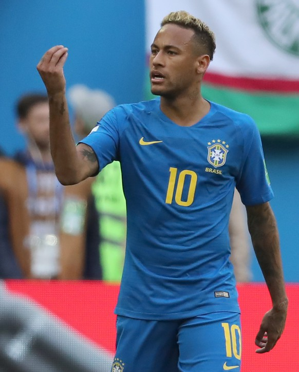 epa06830406 Neymar of Brazil reacts during the FIFA World Cup 2018 group E preliminary round soccer match between Brazil and Costa Rica in St.Petersburg, Russia, 22 June 2018.  (RESTRICTIONS APPLY: Editorial Use Only, not used in association with any commercial entity - Images must not be used in any form of alert service or push service of any kind including via mobile alert services, downloads to mobile devices or MMS messaging - Images must appear as still images and must not emulate match action video footage - No alteration is made to, and no text or image is superimposed over, any published image which: (a) intentionally obscures or removes a sponsor identification image; or (b) adds or overlays the commercial identification of any third party which is not officially associated with the FIFA World Cup)  EPA/GEORGI LICOVSKI   EDITORIAL USE ONLY