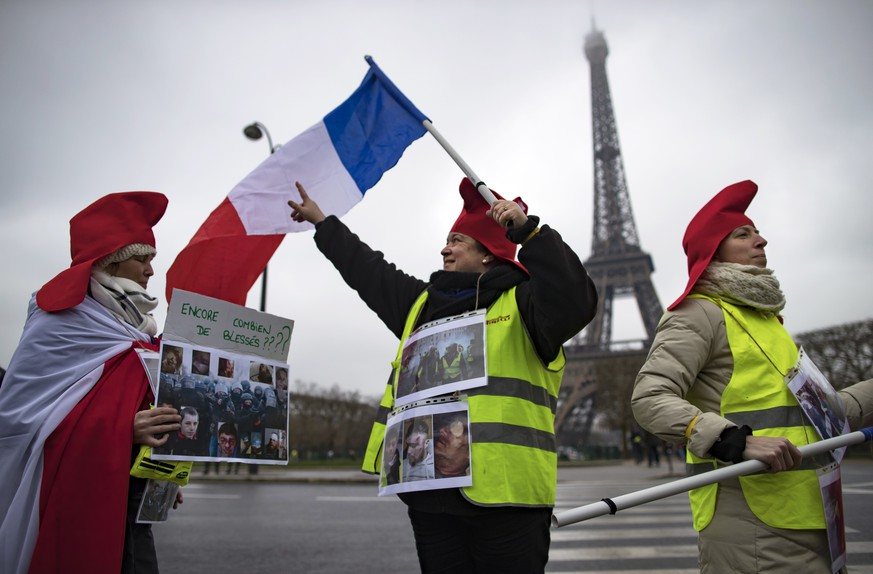 epa07302996 Protesters wearing revolutionnary phrygian caps take part in a Women's 'Gilets Jaunes' (Yellow Vests) protest in front of the Eiffel Tower, in Paris, France, 20 January 2019. The women's protest comes one day after the weekly national Yellow Vest protest, dubbed 'Act X', as it was the tenth national protest on a Saturday. The so-called 'gilets jaunes' (yellow vests) is a grassroots protest movement with supporters from a wide span of the political spectrum, that originally started with protest across the nation in late 2018 against high fuel prices. The movement in the meantime also protests the French government's tax reforms, the increasing costs of living and some even call for the resignation of French president Emmanuel Macron.  EPA/IAN LANGSDON
