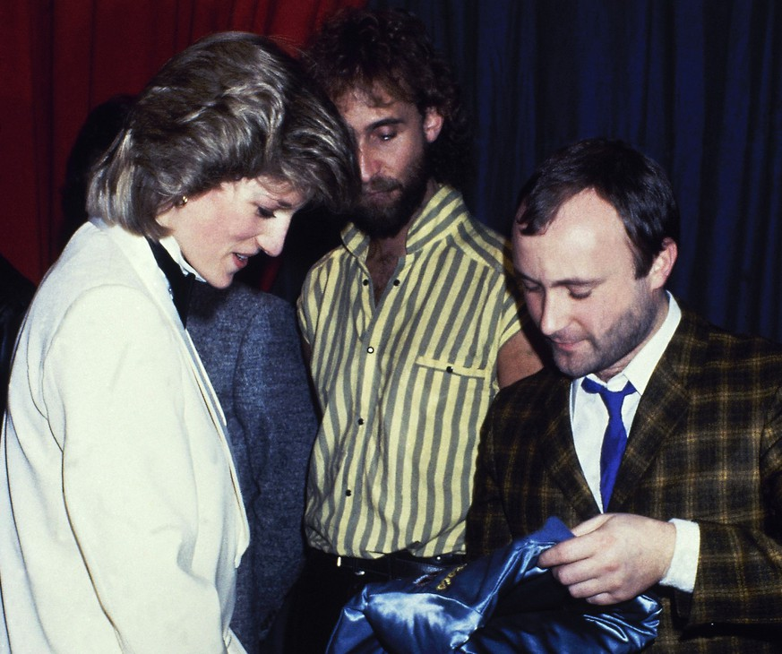 FILE - In this file photo dated Feb. 1984, Britain's Princess Diana talks with rock group
