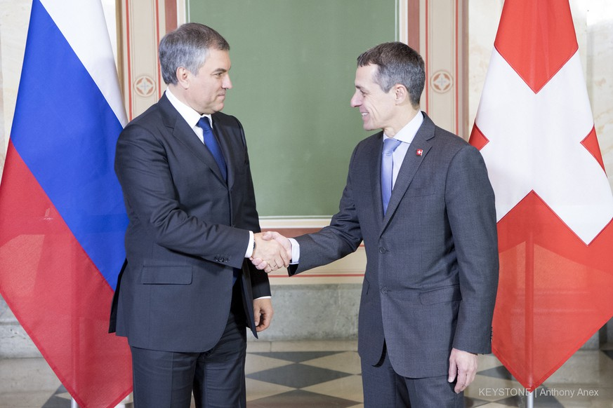 The Swiss Federal Councillor Ignazio Cassis, right, and the Russian State Duma Speaker Vyacheslav Volodin, left, shake hands during a official visit at the Swiss Parliament West, in Bern, Switzerland, this Monday, February 19, 2018. (KEYSTONE/Anthony Anex)