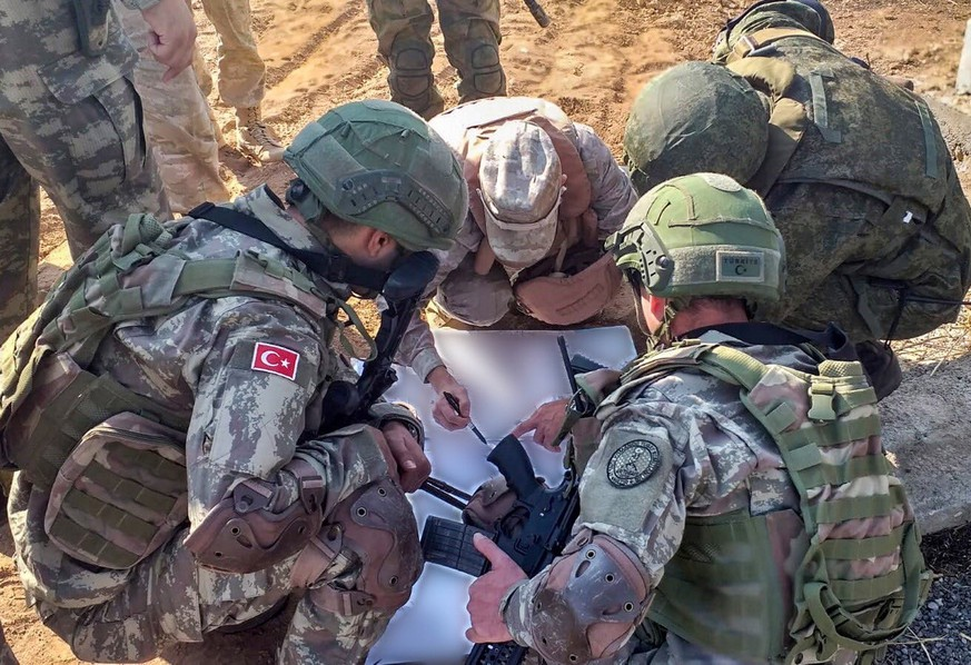 epa07974033 A handout photo made available by the Turkish Defense Ministry press office shows Turkish soldiers meeting with Russian soldiers during a patrol in Ayn Al-Arab, in Northern Syria, 05 November 2019. Turkish and Russian troops conducted their second joint ground patrols in northeast Syria after ab agreement between Turkey and Russia.  EPA/TURKISH DEFENSE MINISTRY PRESS OFFICE HANDOUT  HANDOUT EDITORIAL USE ONLY/NO SALES