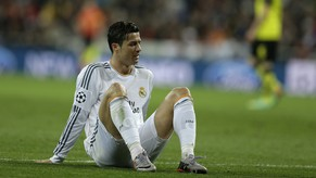 Real's Cristiano Ronaldo pauses during a Champions League quarterfinal first leg soccer match between Real Madrid and Borussia Dortmund at the Santiago Bernabeu   stadium in Madrid, Spain, Wednesday April 2, 2014. (AP Photo/Paul White)