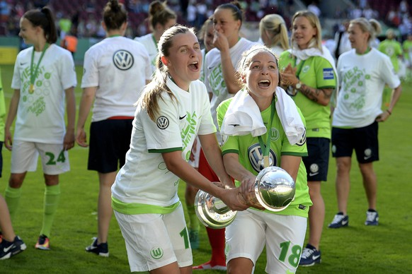 epa05993690 Wolfburg's Noelle Maritz (L) and Vanessa Bernauer (R) celebrate with the trophy after winning the German Women's DFB Cup final between SC Sand and VfL Wolfsburg at Rheinenergiestadion in Cologne, Germany, 27 May 2017.  EPA/SASCHA STEINBACH ATTENTION: The DFB prohibits the utilisation and publication of sequential pictures on the internet and other online media during the match (including half-time).