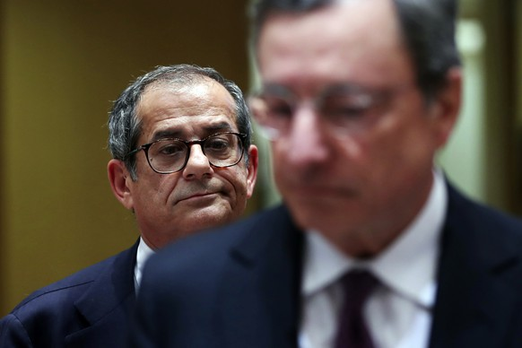 Italian Finance Minister Giovanni Tria, background, and European Central Bank President Mario Draghi enter the chamber after a break during a meeting of Eurogroup Finance Ministers at the European Council headquarters in Brussels, Monday, Nov. 5, 2018. European Finance Ministers urged Italy Monday to respond to European Commission demands that it submit a new budget plan after the EU's executive wing rejected Rome's original spending package. (AP Photo/Francisco Seco)