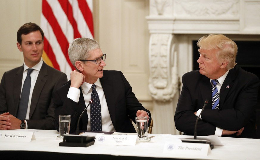 Tim Cook, Chief Executive Officer of Apple, speaks as President Donald Trump, right, and Jared Kushner, White House Senior Adviser, left, listen during an American Technology Council roundtable in the State Dinning Room of the White House, Monday, June 19, 2017, in Washington. (AP Photo/Alex Brandon)