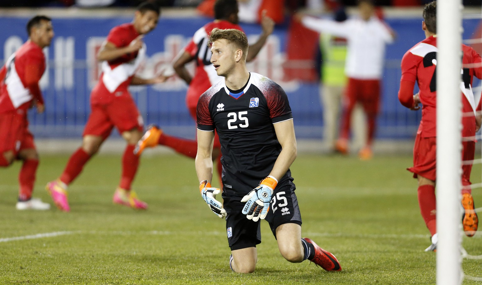 Iceland goalkeeper Frederik Schram reacts after giving up a goal to Peru forward Jefferson Farfan during the second half of an international friendly soccer match Tuesday, March 27, 2018, in Harrison, N.J. Peru won 3-1. (AP Photo/Adam Hunger)