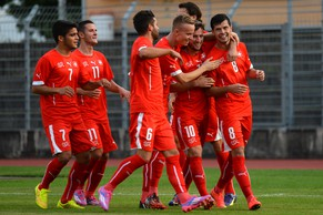 The Swiss U21 players celebrate with Darko Jevic, right, after his goal against Lithuania during the U21 match Switzerland against Lithuania in Lugano, Switzerland, September 8 2014. (KEYSTONE/TI-PRESS/Sara Solca)