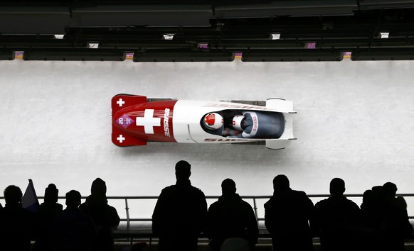 Switzerland's Beat Hefti and Alex Baumann  compete in a heat of the two-man bobsleigh event at the 2014 Sochi Winter Olympics, at the Sanki Sliding Center in Rosa Khutor February 16, 2014.                   REUTERS/Arnd Wiegmann (RUSSIA  - Tags: SPORT BOBSLEIGH OLYMPICS)