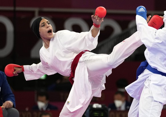 Feryal Abdelaziz of Egypt, left, and Hamideh Abbasali of Iran compete in the women's kumite +61kg elimination round for karate at the 2020 Summer Olympics, Saturday, Aug. 7, 2021, in Tokyo, Japan. (AP Photo/Vincent Thian)
