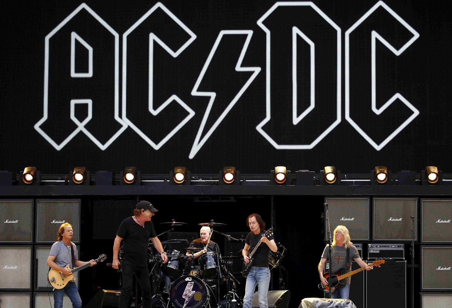 Members of the rock group AC/DC (L-R) Stevie Young, Brian Johnson, Chris Slade, Angus Young and Cliff Williams perform during a rehearsal at Stadium Australia in Sydney, Australia in this November 3, 2015 file photo. Veteran rock band AC/DC has been forced to reschedule 10 dates on the U.S. leg of its