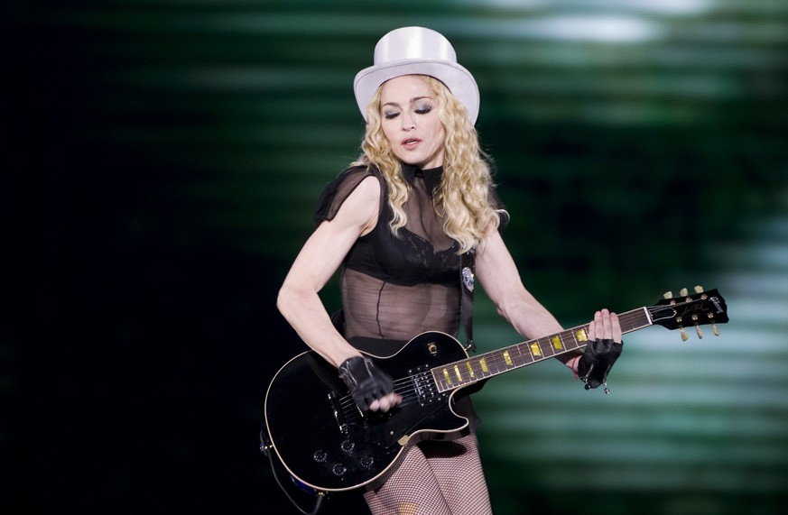 FILE - In this Nov. 29, 2008 file photo,  Madonna, center, performs in Mexico City. The Material Girl will pay tribute to The Purple One with a live performance at the Billboard Music Awards this month. Billboard and Dick Clark productions told The Associated Press on Wednesday, May 11, 2016 that Madonna will honor Prince at the May 22 show. Specific details about the performance weren't revealed. (AP Photo/Eduardo Verdugo)