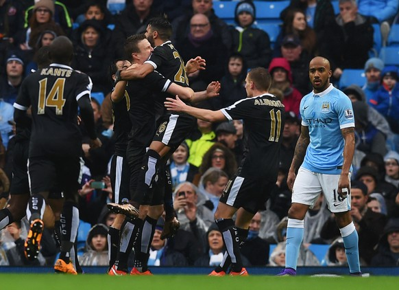 MANCHESTER, ENGLAND - FEBRUARY 06: Robert Huth (4th R) of Leicester City celebrates scoring his team's first goal with his team mates during the Barclays Premier League match between Manchester City and Leicester City at the Etihad Stadium on February 6, 2016 in Manchester, England.  (Photo by Michael Regan/Getty Images)