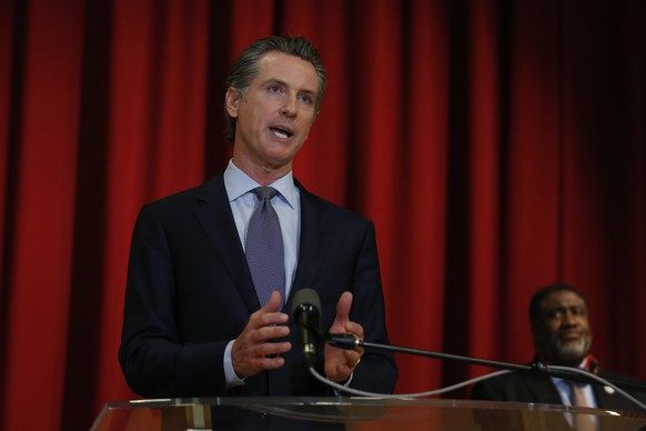 California Gov. Gavin Newsom discusses the pain California's black community is feeling Monday, June 1, 2020, over the death of George Floyd, after a meeting with African American leaders in Sacramento, Calif. Newsom urged people to continue expressing themselves through protest, and criticized people who are trying to exploit the protests with violence. Floyd, a black man, died after being restrained by Minneapolis police officers Memorial Day.(AP Photo/Rich Pedroncelli, Pool) Gavin Newsom