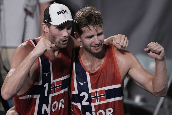 Anders Berntsen Mol, left, of Norway, and teammate Christian Sandlie Sorum, celebrate winning a men's beach volleyball semifinal match against Latvia at the 2020 Summer Olympics, Thursday, Aug. 5, 2021, in Tokyo, Japan. (AP Photo/Petros Giannakouris) Anders Berntsen Mol,Christian Sandlie Sorum