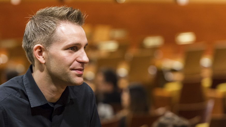 FILE - In this Oct. 6, 2015 file photo Austria's Max Schrems listens to a ruling at the European Court of Justice in Luxembourg. The Austrian activist has launched a European watchdog organization aimed at protecting users' rights against Google, Facebook and other mass user platforms. (AP Photo/Geert Vanden Wijngaert, file)