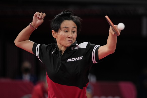 Austria's Liu Jia competes during the table tennis women's singles third round match against Adriana Diaz, of Puerto Rico at the 2020 Summer Olympics, Tuesday, July 27, 2021, in Tokyo. (AP Photo/Kin Cheung)