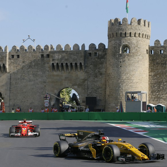 epa06045878 German Formula One driver Nico Hulkenberg of Renault (front) and Finnish Formula One driver Kimi Raikkonen of Scuderia Ferrari in action during the second practice session of the Formula One Grand Prix of Azerbaijan at the Baku City Circuit, in Baku, Azerbaijan 23 June 2017. The 2017 Formula One Grand Prix of Azerbaijan will take place on 25 June.  EPA/ZURAB KURTSIKIDZE