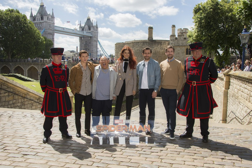 Tower of London Yeomen Warders, far left and far right, stand alongside actors Tom Holland, from left, Jacob Batalon, Zendaya, Jake Gyllenhaal, and Director Jon Watts as they pose for photographers upon arrival at the photo call for 'Spiderman: Far From Home' in London, Monday, June 17, 2019. (Photo by Joel C Ryan/Invision/AP)