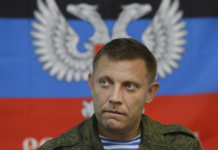 FILE - In this Monday, Aug. 11, 2014 file photo, Alexander Zakharchenko, pro-Russian rebel leader speaks during a press conference in Donetsk, eastern Ukraine. The leader of the Russia-backed separatists fighting in eastern Ukraine's Donetsk region was killed Friday, Aug. 31, 2018 by an explosion at a cafe, the separatists' news agency said Friday. Rebel news agency DAN said the afternoon explosion that killed Alexander Zakharchenko, 42, tore through the cafe in the region's principal city.(AP Photo/Sergei Grits, File)