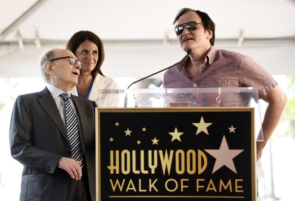 Italian composer Ennio Morricone, left, reacts as director Quentin Tarantino speaks during a ceremony presenting Morricone with a star on the Hollywood Walk of Fame on Friday, Feb. 26, 2016, in Los Angeles. Morricone is nominated for an Academy Award for Best Original Score in Sunday's Oscars ceremony for Tarantino's film