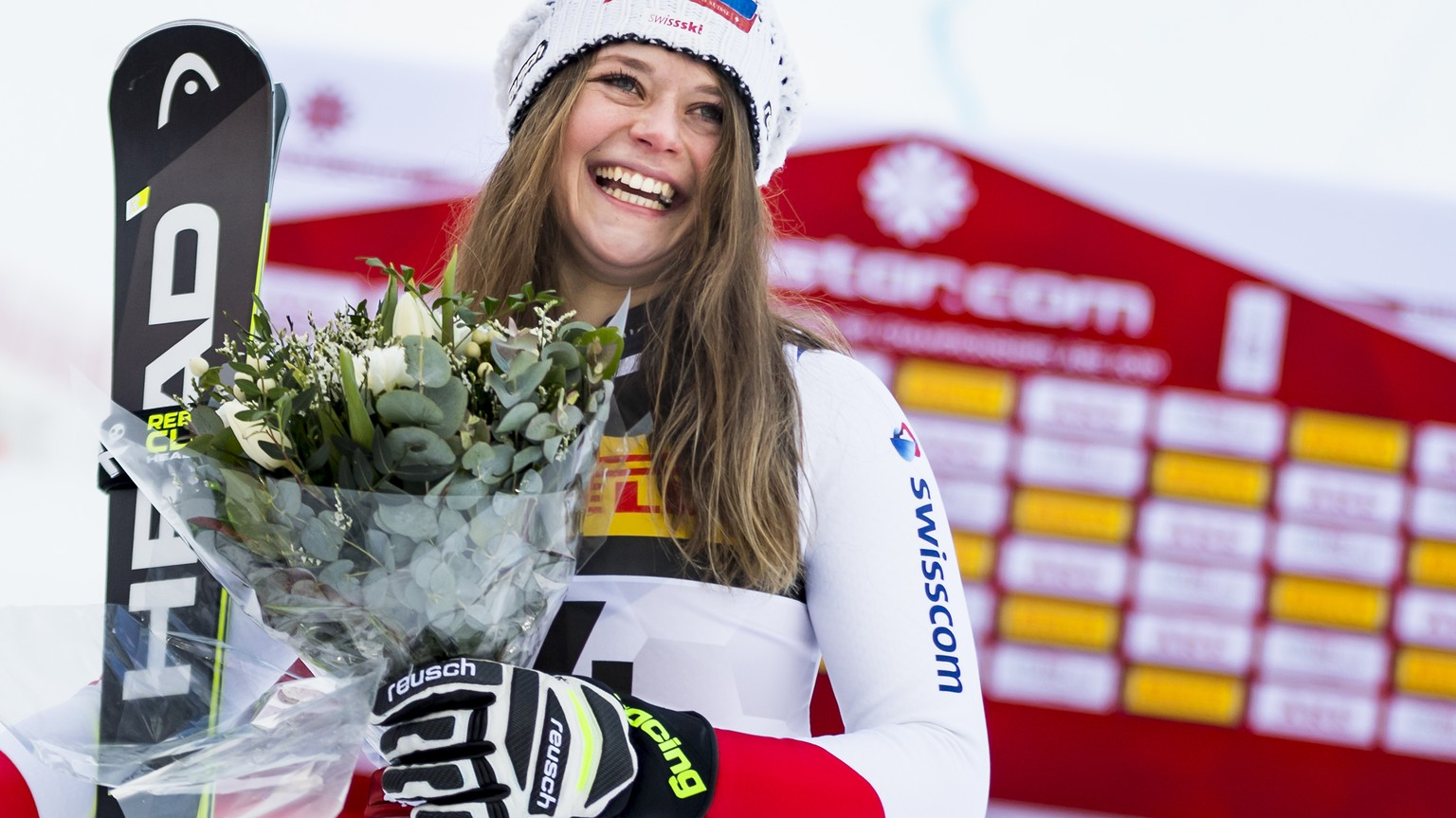 Corinne Suter of Switzerland, bronze medal, celebrates during the flowers cereemony after the women Super-G race at the 2019 FIS Alpine Skiing World Championships in Are, Sweden Tuesday, February 5, 2019. (KEYSTONE/Jean-Christophe Bott)