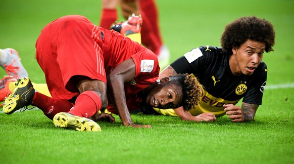 epa07755344 Bayern's Kingsley Coman (L) in action against Dortmund's Axel Witsel (R) during the German Supercup soccer match between Borussia Dortmund and FC Bayern Muenchen in Dortmund, Germany, 03 August 2019.  EPA/SASCHA STEINBACH CONDITIONS - ATTENTION: The DFL regulations prohibit any use of photographs as image sequences and/or quasi-video.