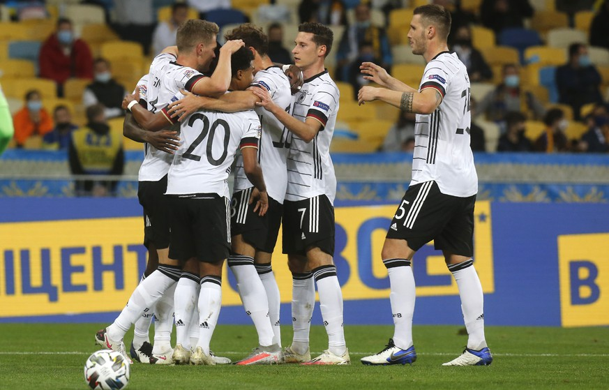 Germany players celebrate after Germany's Matthias Ginter scored his side's opening goal during the UEFA Nations League soccer match between Ukraine and Germany at the Olimpiyskiy Stadium in Kyiv, Ukraine, Saturday, Oct.10, 2020. (AP Photo/Efrem Lukatsky)