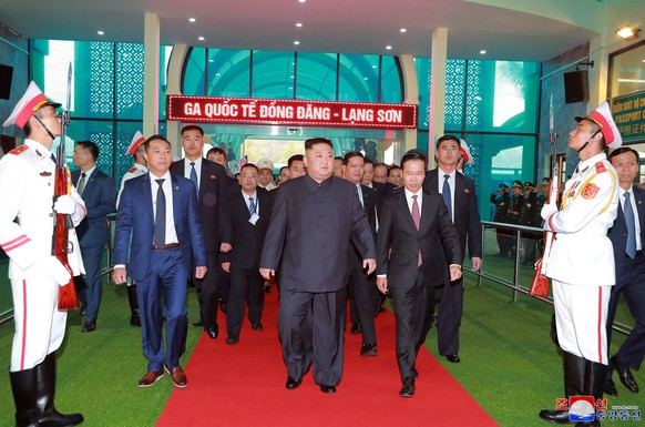 """In this Tuesday, Feb. 26, 2019, photo provided by the North Korean government, North Korean leader Kim Jong Un, center, arrives at the Dong Dang railway station in Dong Dang, Vietnam, ahead of his second summit with U.S. President Donald Trump. The content of this image is as provided and cannot be independently verified. Korean language watermark on image as provided by source reads: """"KCNA"""" which is the abbreviation for Korean Central News Agency. (Korean Central News Agency/Korea News Service via AP)"""