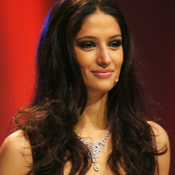 FILE - 10 March 2014: According to media reports, Swiss moderator and former Miss Switzerland Melanie Winiger confirmed her relationship with singer Campino of the German band Die Toten Hosen. LUCERNE, SWITZERLAND - DECEMBER 02: Melanie Winiger moderate the UEFA EURO2008 Final Draw at the KKL on December 2, 2007 in Lucerne, Switzerland.  (Photo by Lars Baron/Bongarts/Getty Images)