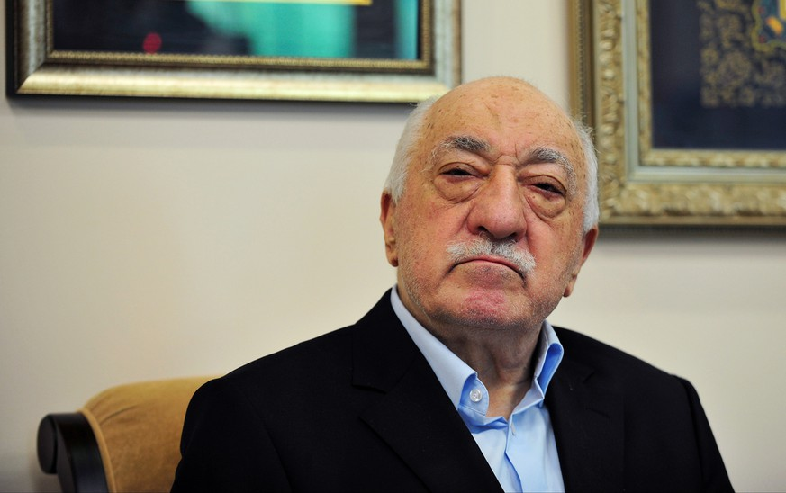 Islamic cleric Fethullah Gulen poses for a photo while speaking to members of the media at his compound, Sunday, July 17, 2016, in Saylorsburg, Pa. Turkish officials have blamed a failed coup attempt on Gulen, who denies the accusation. (AP Photo/Chris Post)