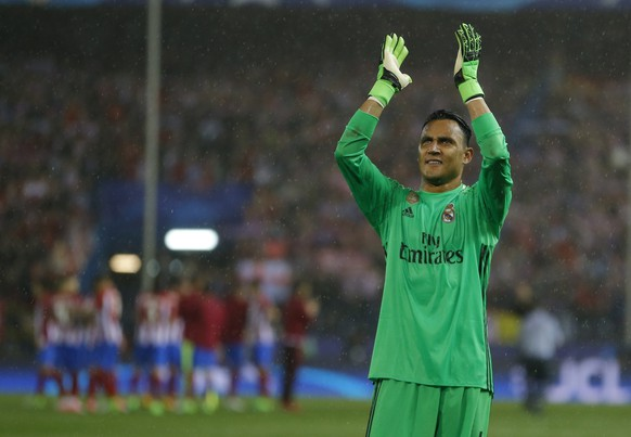 Real Madrid's goalkeeper Keylor Navas waves to his fans after the Champions League semifinal second leg soccer match between Atletico Madrid and Real Madrid at the Vicente Calderon stadium in Madrid, Spain, Wednesday, May 10, 2017. (AP Photo/Francisco Seco)