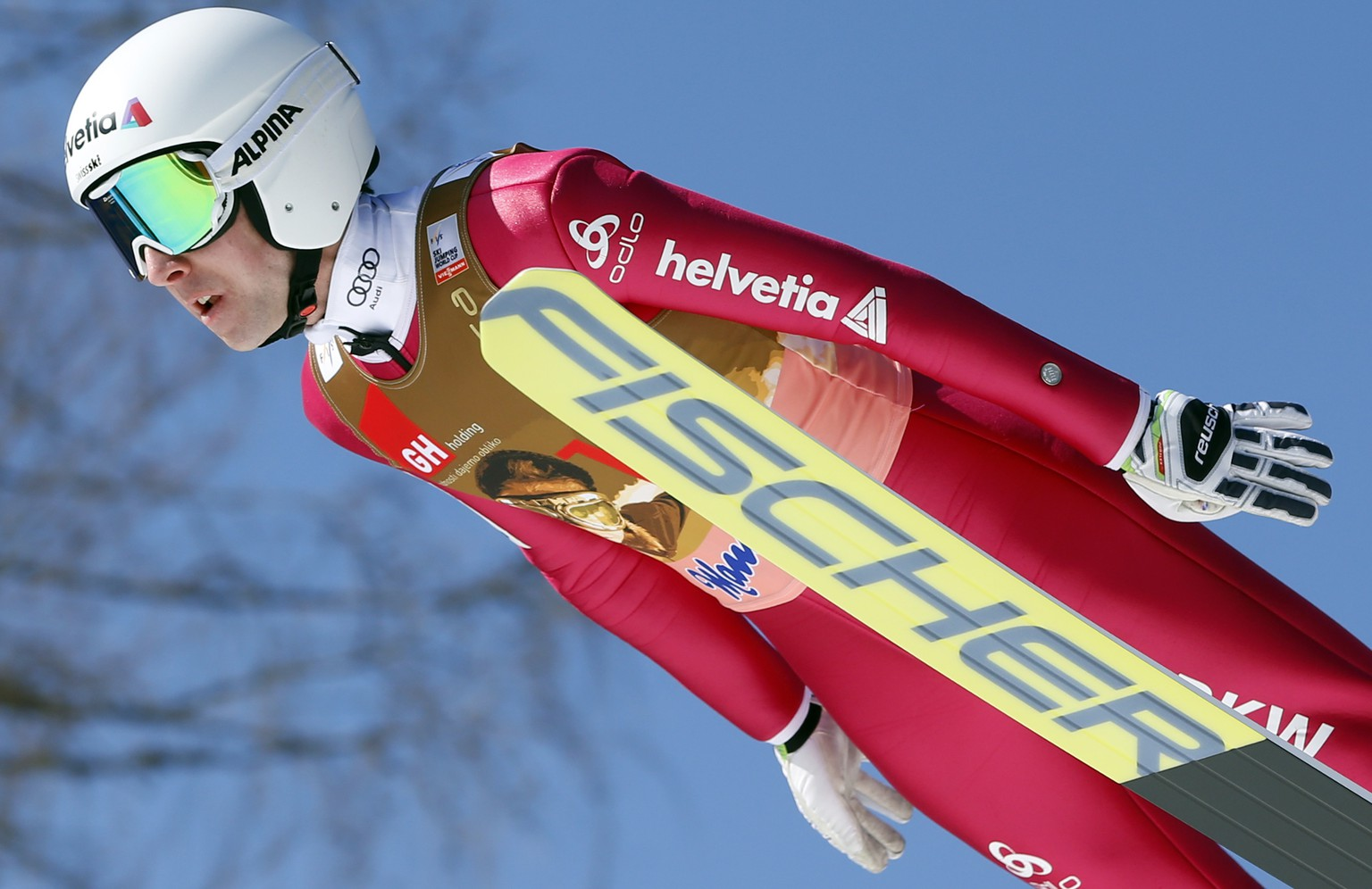 Simon Ammann of Switzerland competes to place eighth at the Ski Jumping World Cup individual event in Planica, Slovenia, Sunday, March 20, 2016. (AP Photo/Darko Bandic)