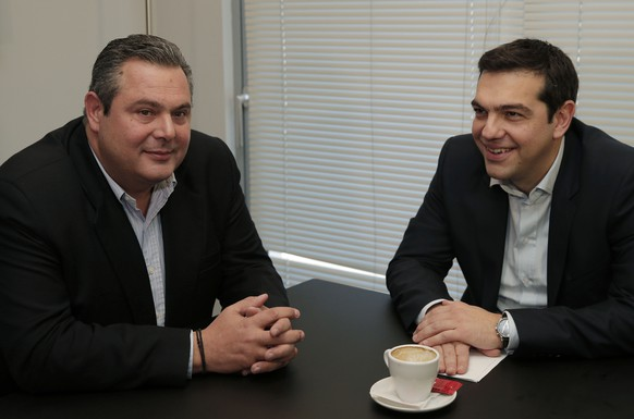 Alexis Tsipras, right, leader of Greece's left-wing main opposition Syriza party, and Panos Kammenos, chairman of the right-wing Independent Greeks party, smile during their meeting in Athens, Monday, Jan. 26, 2015. Syriza party launched coalition talks Monday, hours after a landmark general election victory fought on a pledge to rewrite the country's massive bailout deal with the eurozone. Tsipras' party just missed a majority in parliament after defeating Prime Minister Antonis Samaras' conservative coalition by a wider margin than expected. (AP Photo/Lefteris Pitarakis, Pool)