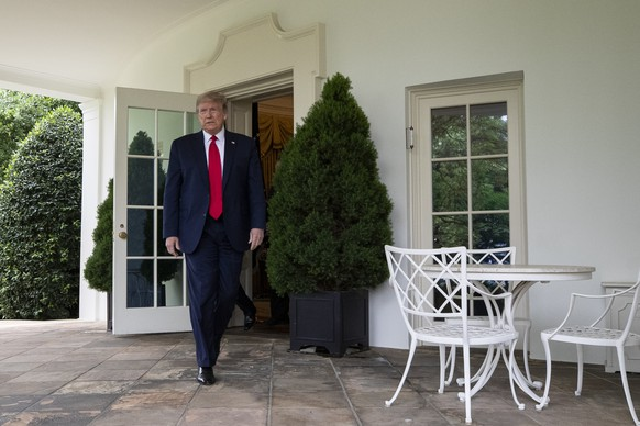 President Donald Trump walks out of the Oval Office to speak in the Rose Garden of the White House, Friday, May 29, 2020, in Washington. (AP Photo/Alex Brandon) Donald Trump