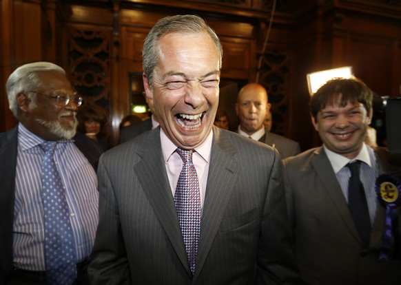 Nigel Farage leader of Britain's UK Independence Party (UKIP) laughs as he arrives to hear results of the south east region European Parliamentary Election vote at the Guildhall in Southampton, England, Sunday, May 25, 2014. From Portugal to Finland, voters of 21 nations cast ballots Sunday to decide the makeup of the next European Parliament and help determine the European Union's future leaders and course. (AP Photo/Kirsty Wigglesworth)