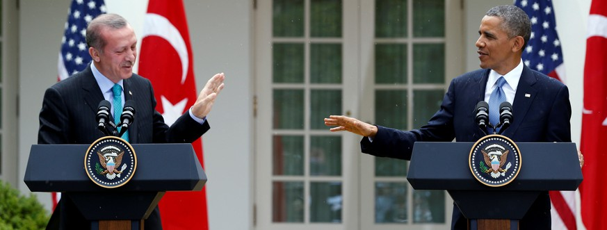 FILE PHOTO -  U.S. President Barack Obama (R) and Turkish Prime Minister Recep Tayyip Erdogan hold a joint news conference in the White House Rose Garden in Washington, May 16, 2013. REUTERS/Jason Reed/File Photo