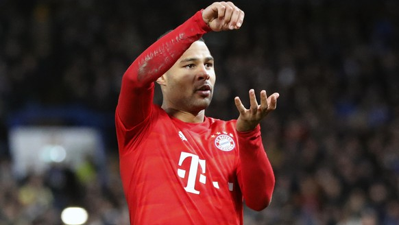 Bayern's Serge Gnabry celebrates after scoring the opening goal of his team during the Champions League round of 16 soccer match between Chelsea and Bayern Munich at Stamford Bridge in London, England, Tuesday, Feb. 25, 2020. (AP Photo/Frank Augstein)