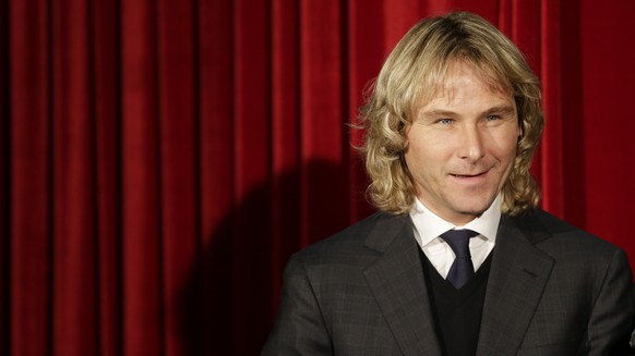 2003 European Footballer of the Year Pavel Nedved smiles before unveiling his wax figure at the Grevin Wax museum in Prague, Czech Republic, Monday, Dec. 1, 2014. (AP Photo/Petr David Josek)