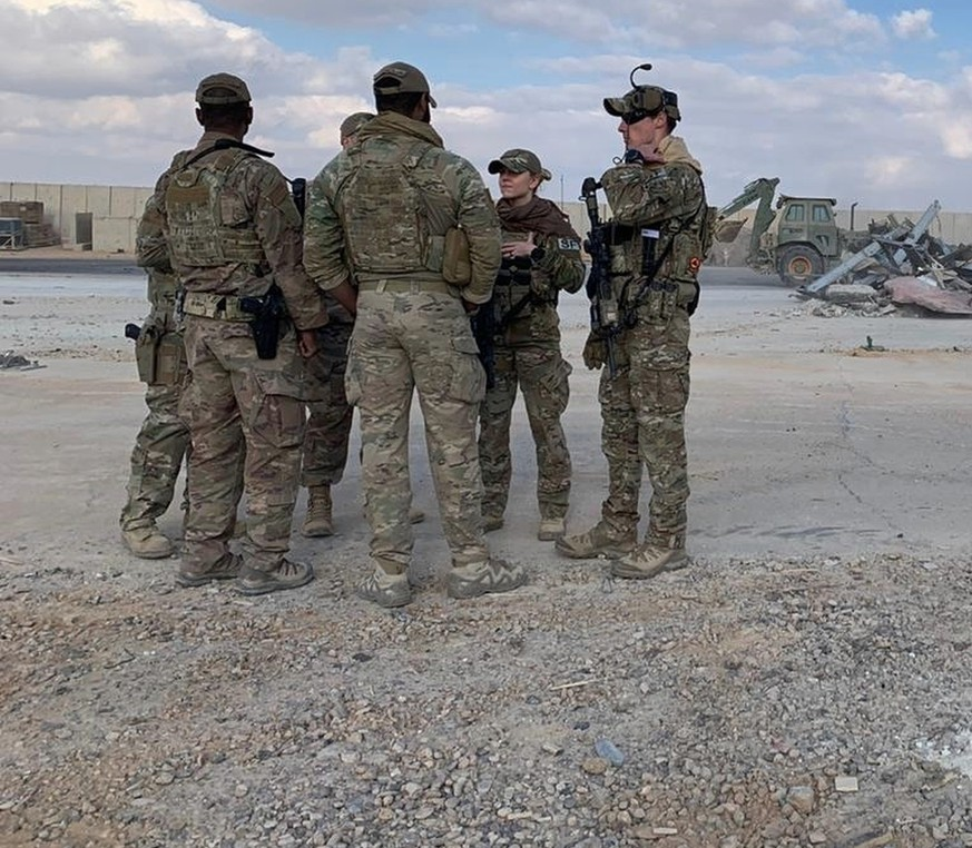 U.S. Soldiers stand while bulldozers clear rubble and debris at Ain al-Asad air base in Anbar, Iraq, Monday, Jan. 13, 2020. Ain al-Asad air base was struck by a barrage of Iranian missiles on Wednesday, in retaliation for the U.S. drone strike that killed atop Iranian commander, Gen. Qassem Soleimani, whose killing raised fears of a wider war in the Middle East. (AP Photo/Ali Abdul Hassan)