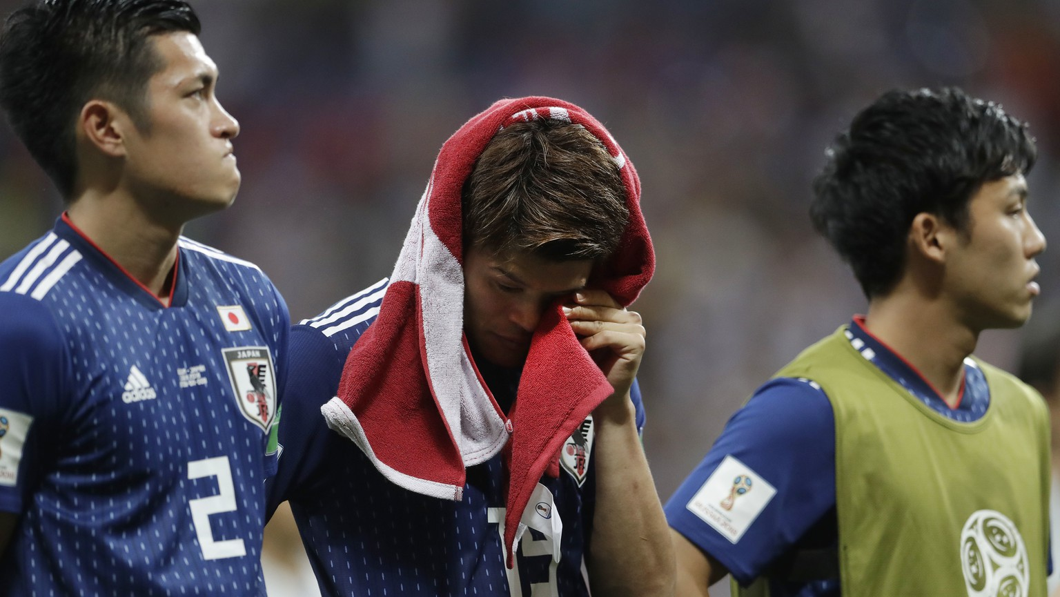 Japan's disappointed Hiroki Sakai drys a tear with a shirt after losing the round of 16 match between Belgium and Japan at the 2018 soccer World Cup in the Rostov Arena, in Rostov-on-Don, Russia, Monday, July 2, 2018. (AP Photo/Petr David Josek)